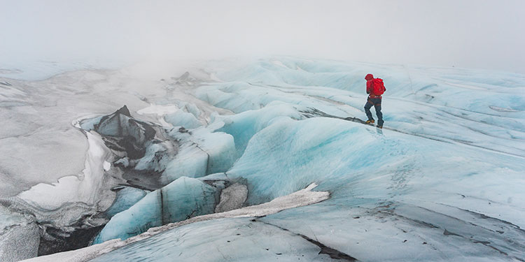 man hiking on glacier in iceland - alaska photography guides
