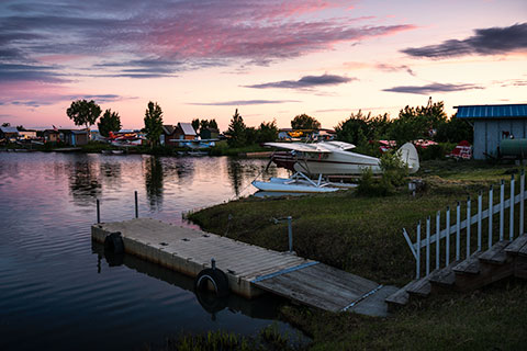 floatplane parked at slip on lake hood at sunset - anchorage photo tour