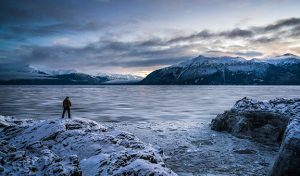 man photographing ice flows on turnagain arm from beluga point - alaska photo tour
