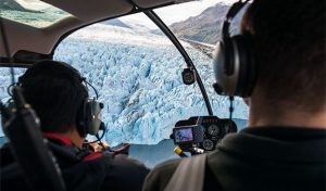 men in helicopter flying over knik glacier - alaska photo tour