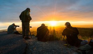 men with tripods photographing sunset at glen alps - alaska photo tour