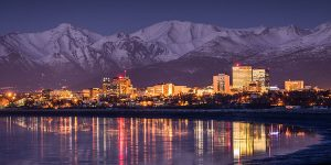 anchorage city skyline at twilight with lights reflecting on cook inlet - winter photo tour