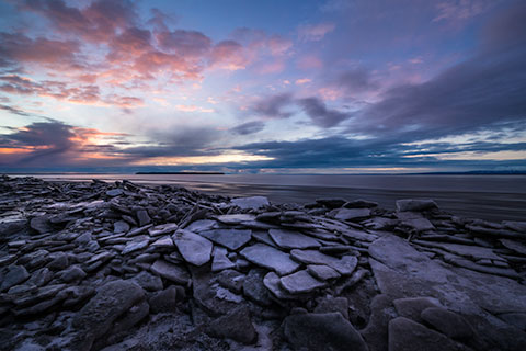 ice chunks on cook inlet coast at sunset - winter photo tour