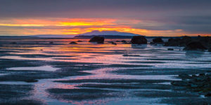 colorful sunset reflecting on the mudflats of turnagain arm - 4 hour photo tour