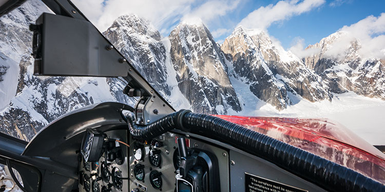 inside of dehavilland otter flying over jagged peaks around denali - aerial photography