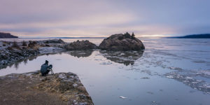 man photographing sunset at beluga point - winter photography tips