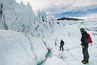 guide and photographer hiking through crevasses on matanuska glacier - photograph glaciers in winter