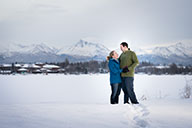Couple embrace on frozen lake at sunset - winter photography tips