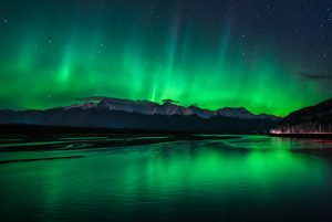 aurora rays reflecting in knik river - northern lights photo tour