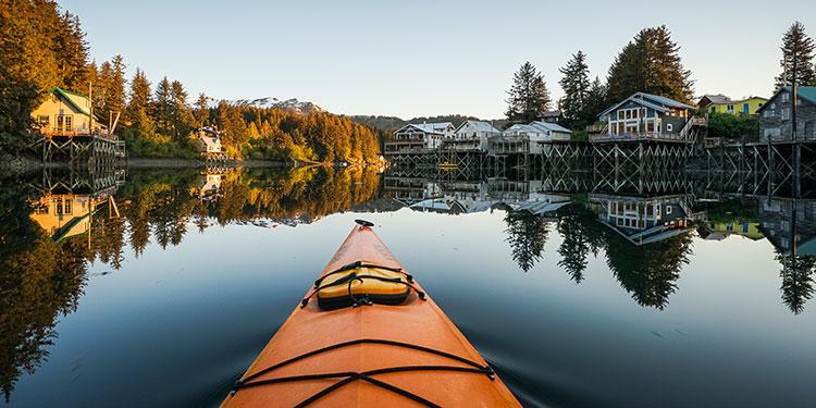 orange kayak bow in the slough - seldovia, alaska