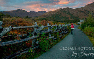 woman walking on path at glen alps during summer sunset - chasing light