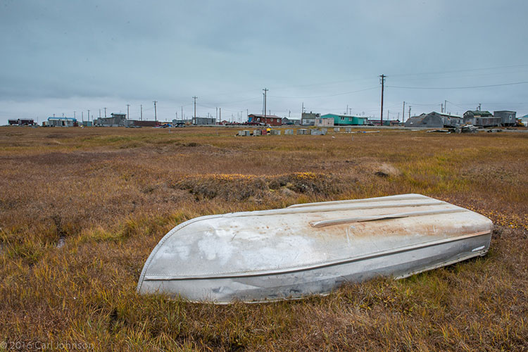 overturned skiff in native village - polar bear photography tour