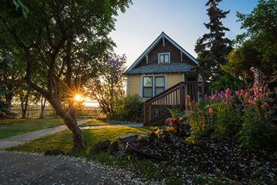oscar anderson house at sunset in summer - anchorage walking tour
