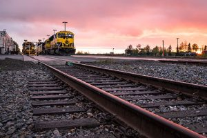 alaska railroad train engine on tracks at low angle during sunset - anchorage walking tour
