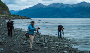 men with tripods photographing sunset on turnagain arm - alaska photo tour