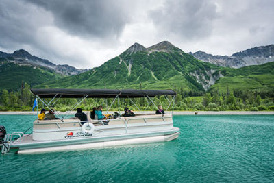 tourist bear viewing from covered pontoon boat - alaska brown bear