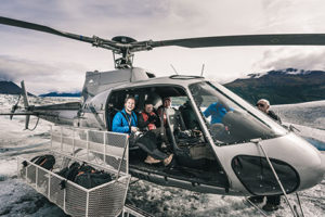 passengers in helicopter with door off - knik glacier
