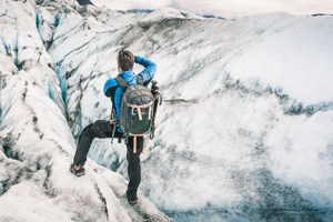 man photographing ice crevasse - knik glacier