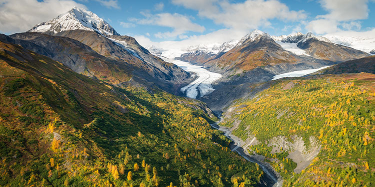 aerial view of river ravine in chugach mountains during autumn - helicopter photography tour