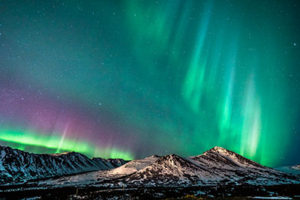 multi-colored northern lights dancing over chugach mountains - alaska photography tours