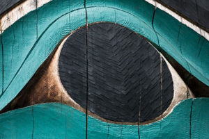 close up of totem pole eagle eye - alaska photography tours
