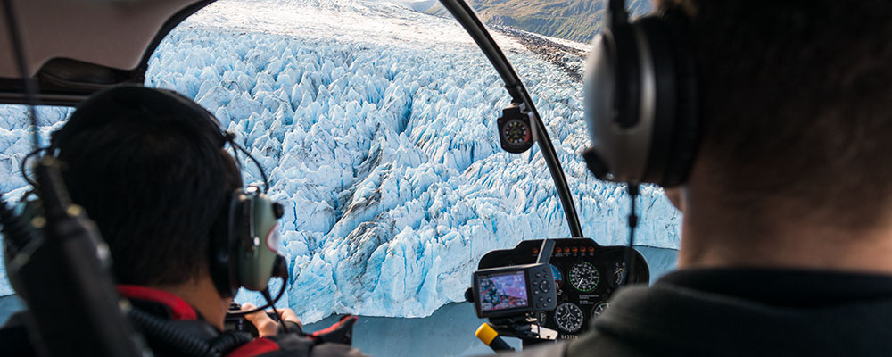 men in helicopter viewing knik glacier - guide corner