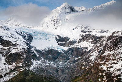 aerial view of alpine glacier with new snow on peaks in autumn