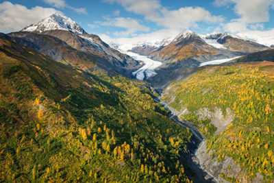 aerial view of alpine glacier in autumn - helicopter photo tour