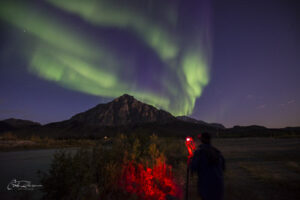 Photographer with aurora - photography workshops