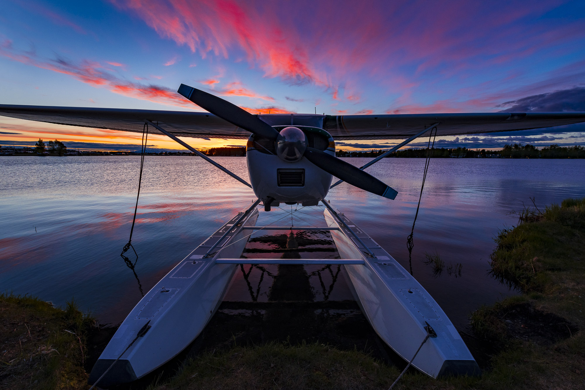 Float plane at sunset is perfect for your Alaska backyard vacation