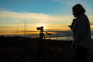 woman photographing scenery - Alaska photography tours