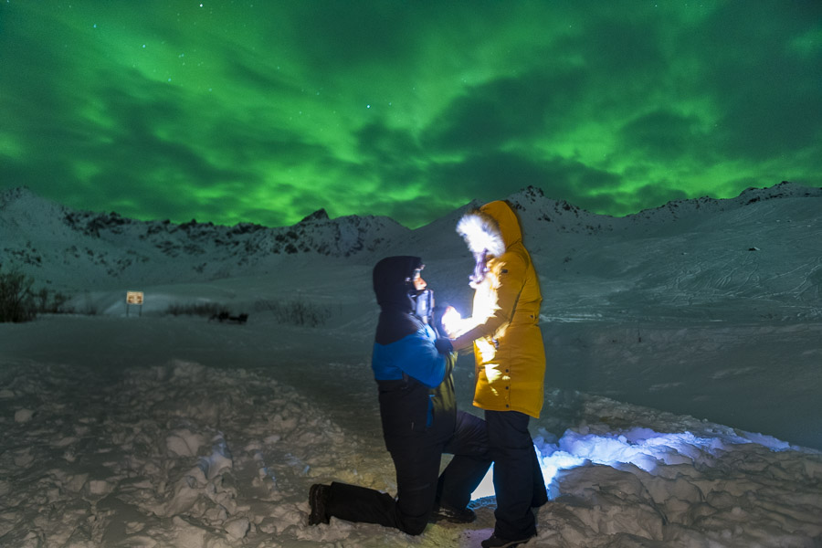 Marriage proposal under aurora borealis